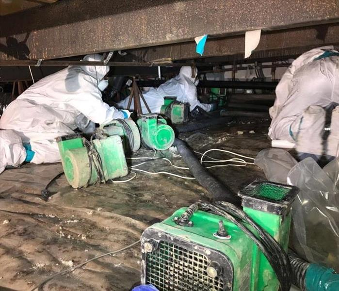 SERVPRO worker sets up air movers to dry out.