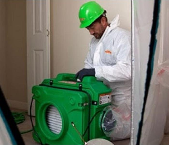 SERVPRO worker setting up air scrubber