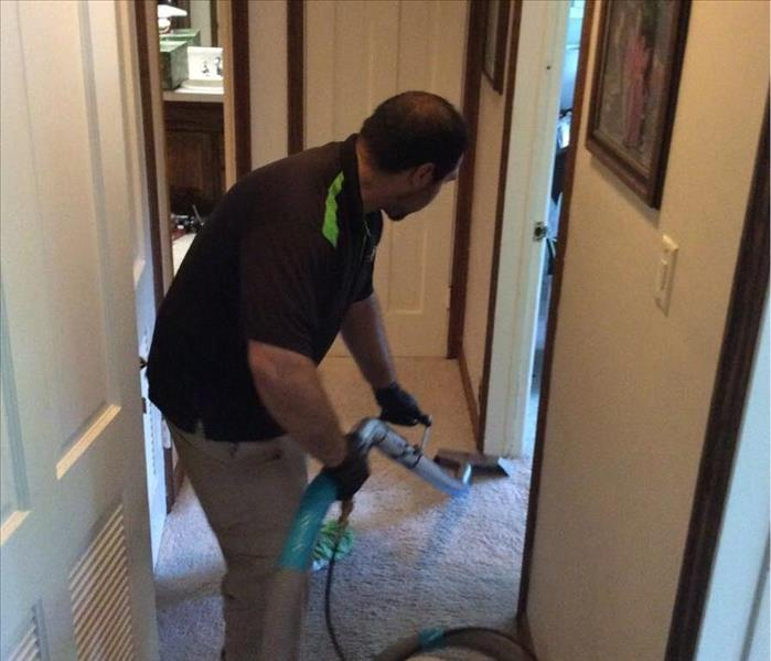 SERVPRO worker extracting water